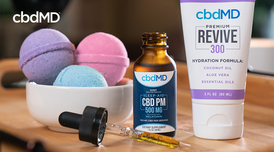 Various CBD products including tinctures and bath bombs from cbdmd sit on a counter