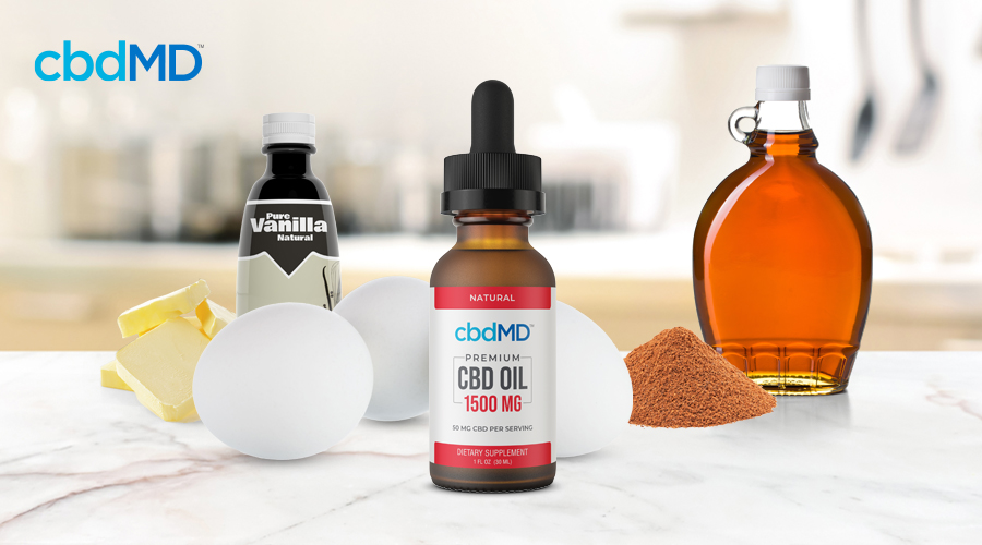 A bottle of 1500 mg cbd oil tincture from cbdmd sits among french toast ingredients
