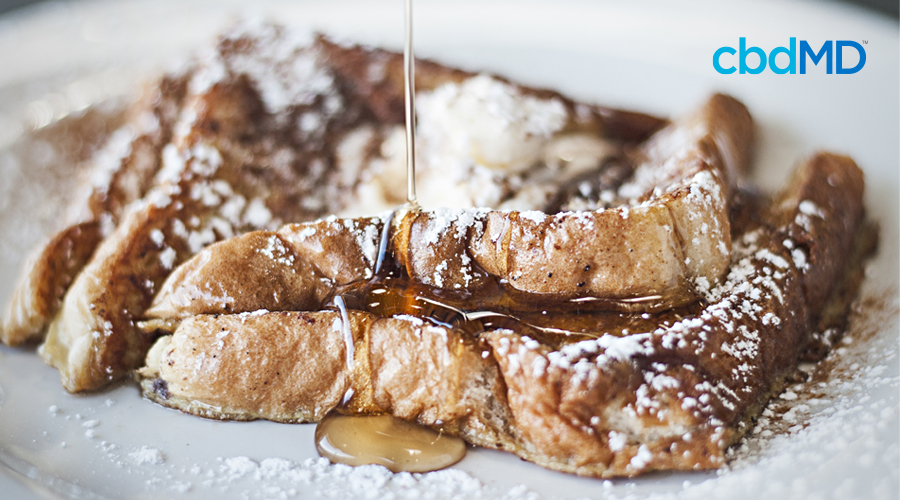 A fresh stack of cbd french toast sits on a plate