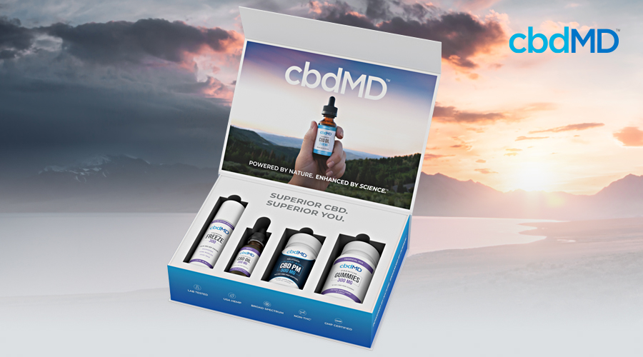 A cbd starter kit from cbdmd sits against the backdrop of a setting sun