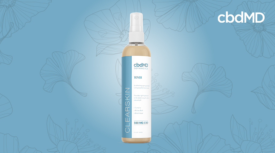 A bottle of clearskin toner from cbdmd botanicals sits against a blue background