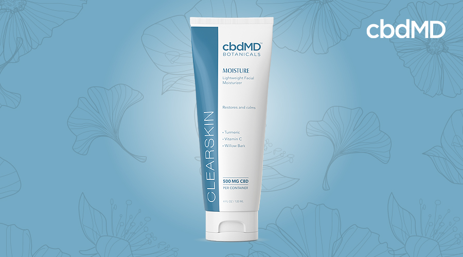A tube of clearskin moisture from cbdmd botanicals sits against a blue background