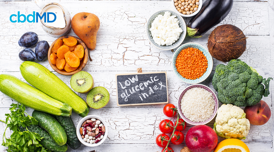 A large assortment of fruits, veggies, and nuts that are skin power foods sits all together