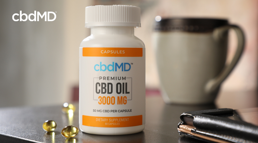 cbdMD 3000 mg CBD capsules on table with coffee cup in the background