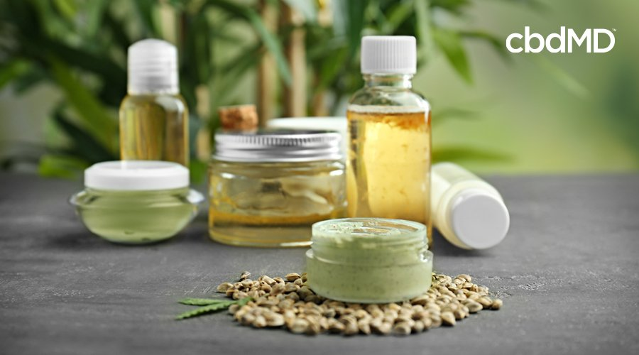A variety of hemp derived plant products sit next to each other on a table