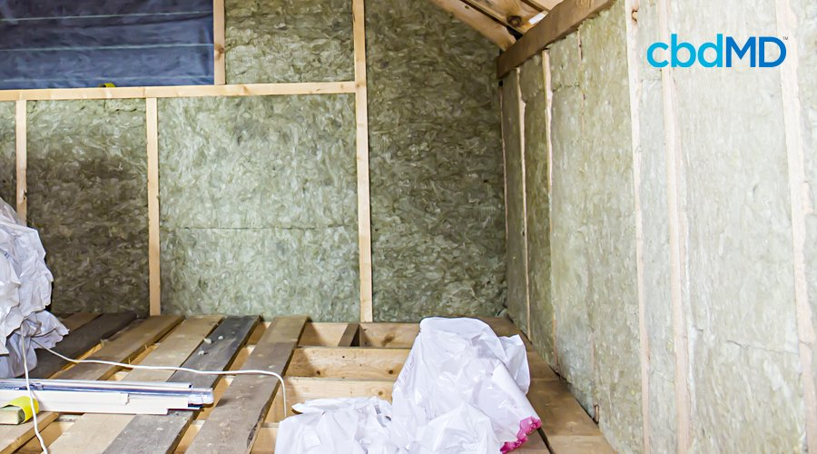 A house in the process of being built shows hemp derived insulation in the walls