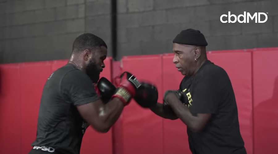 Tyron woodley trains with his trainer in preparation for ufc 178