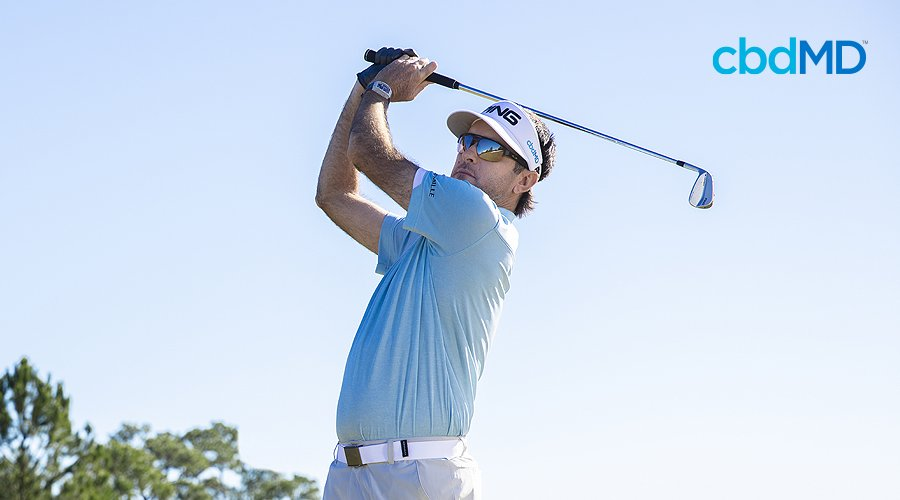 Bubba watson tees off with the sky in the background