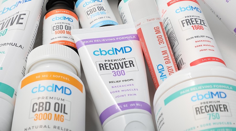 A group of topical and oral products from cbdmd sit together on a table