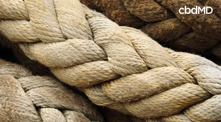 A very close up image of broad, woven hemp rope
