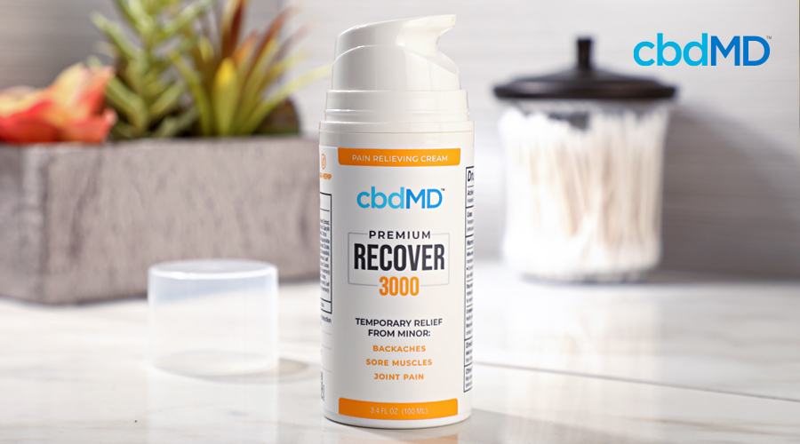 A pump bottle of 3000 mg cbd recover from cbdmd sits on a bathroom counter
