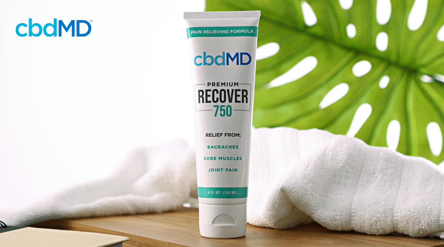 A tube of 750 mg cbd recover from cbdmd sits on a spa countertop