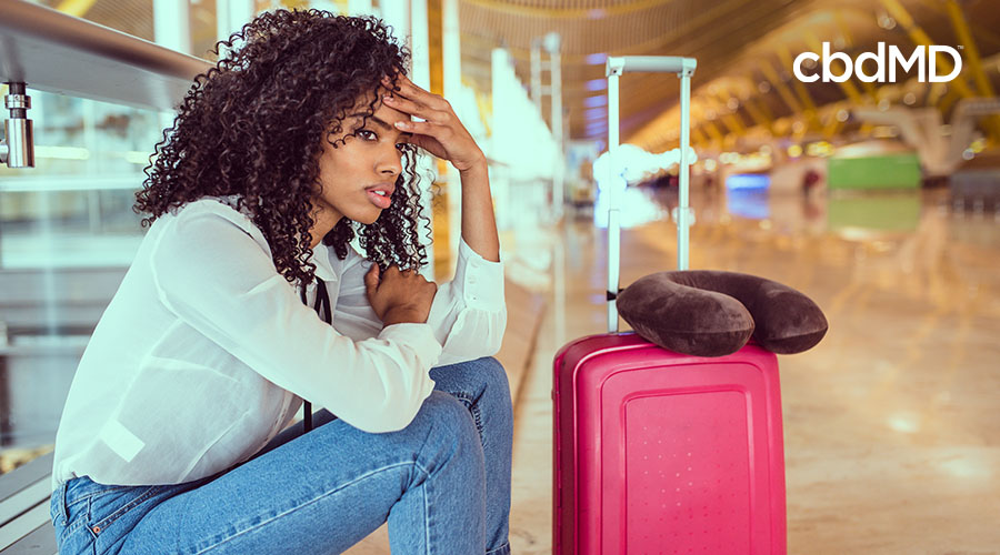 tired woman sitting in airport
