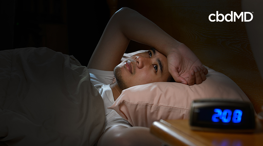 person having a hard time sleeping at two o'clock in the morning