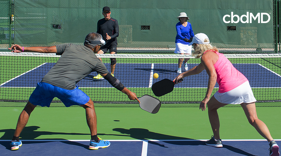Couples playing Tennis