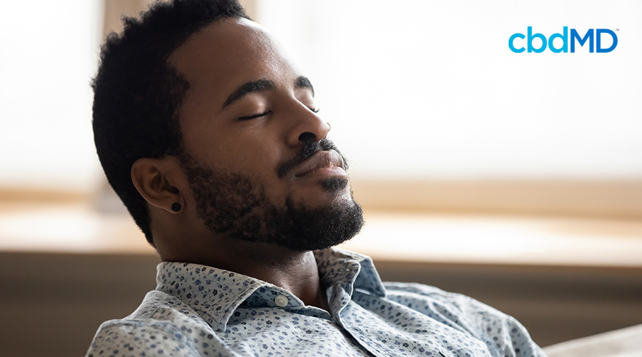 man relaxing after ingesting cbd oil