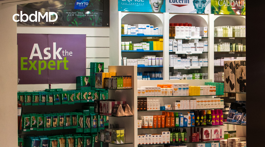 A store display showcases a wide variety of CBD based products inside a CBD specialty store