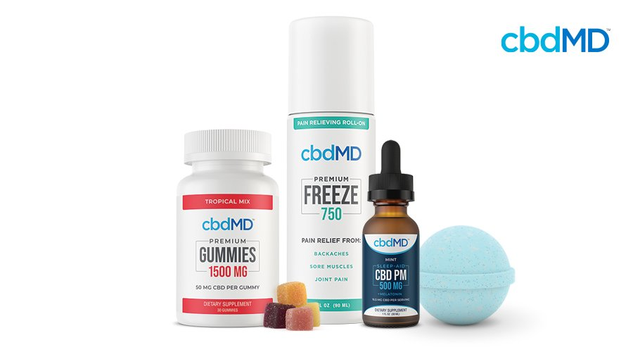 Bottle of cbdMD 1500 mg CBD gummies with red label and stack of square gummies next to 750 mg Freeze roll-on and bottle of 500 mg CBD PM with blue CBD bath bomb