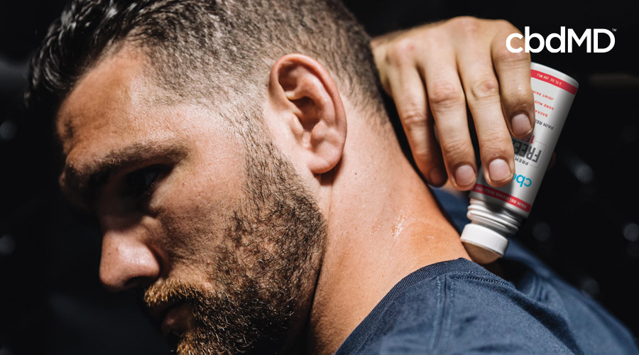 Former MMA champ Mike Bisping rubs CBD Freeze 1500 mg roller on the back of his neck