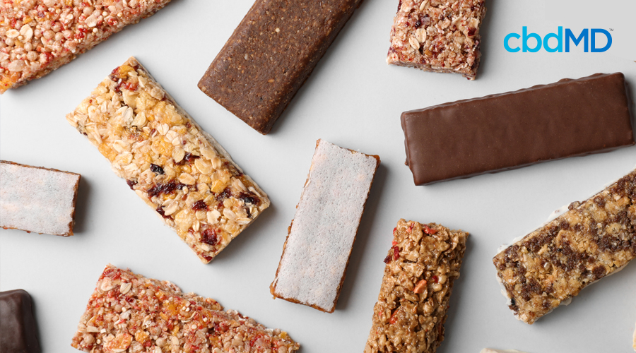 Variety of protein bars with assortment of nuts, berries, fruits, oats, and chocolate