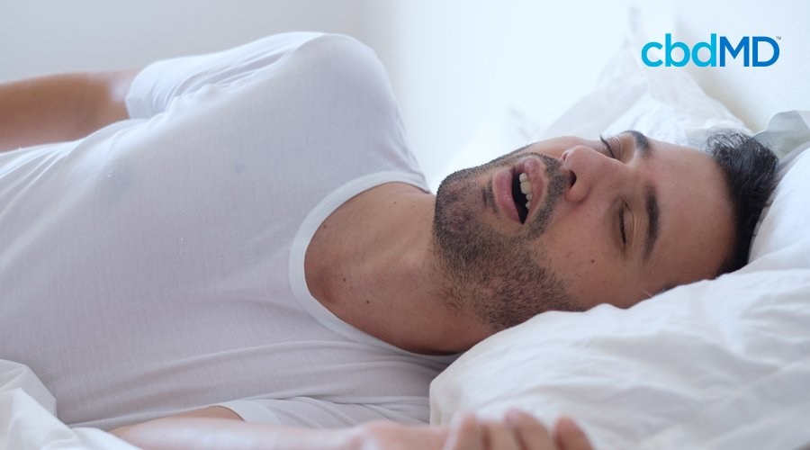 Man with a white t-shirt sleeping