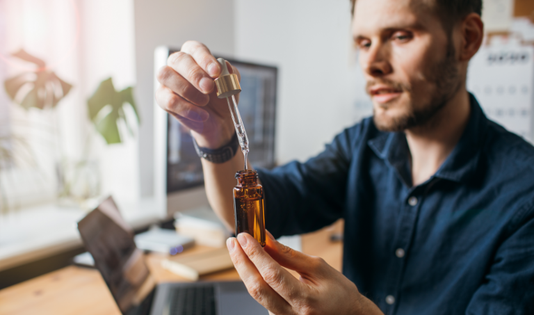 Picture Of A Man Looking Into A Tincture Vile