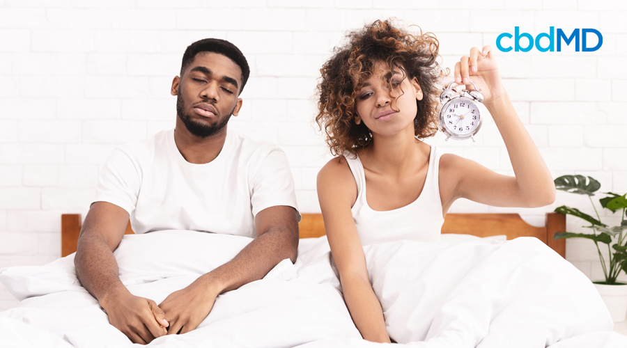 Woman and Man in Bed Sleep